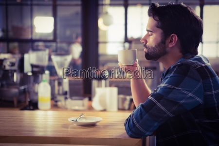 worried man drinking a coffee