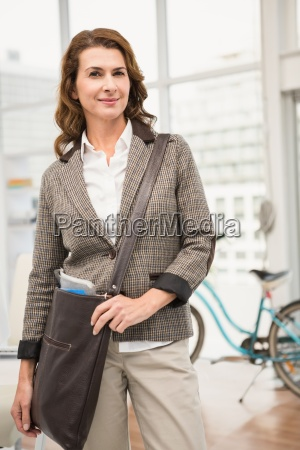 smiling casual businesswoman posing