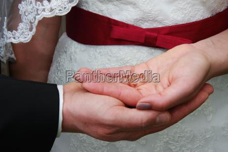 wedding rings in hands of bride