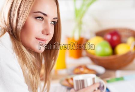 cute female having morning coffee