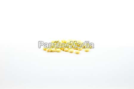 yellow pills isolated on white background