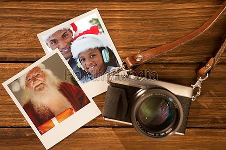 composite image of happy santa holding