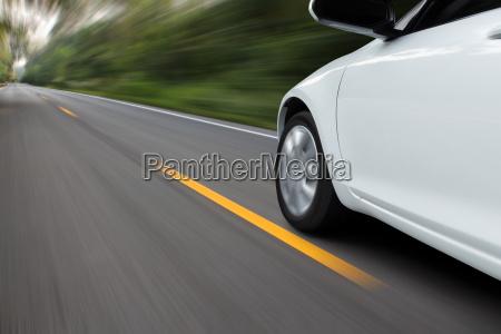 speed movement car on rural asphalt