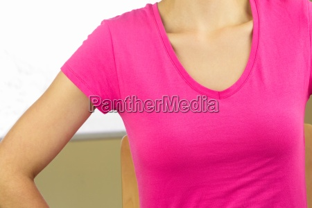 mid section of woman wearing pink