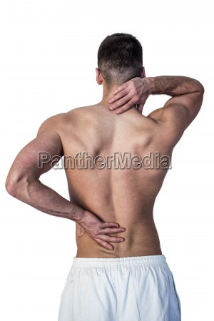 rear view of man suffering from
