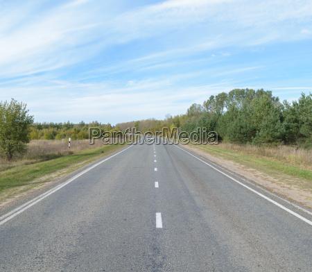suburban asphalt highway with white intermittent