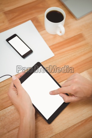 man using digital tablet with smartphone