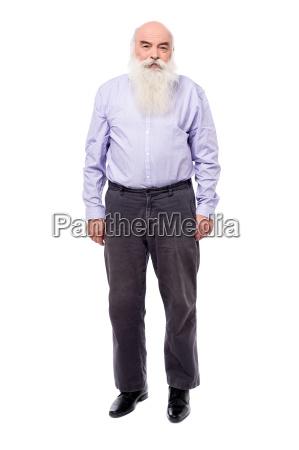 senior man posing seriously