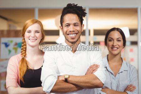 businessman with female colleagues standing with