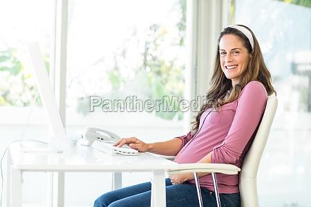 portrait of happy businesswoman working at