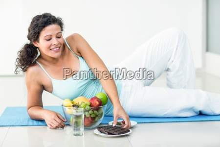 pregnant woman about to hold chocolate