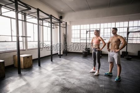 crossfit couple posing with hands on