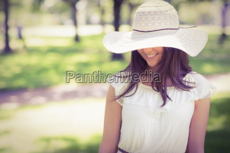 smiling young woman in sun hat