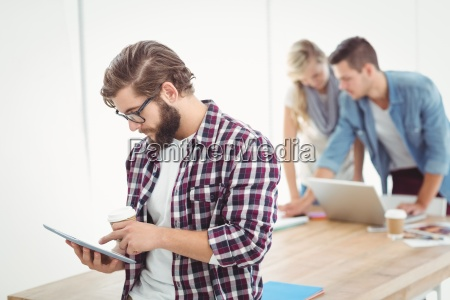 businessman using digital tablet and holding