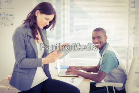 portrait of smiling businessman working on