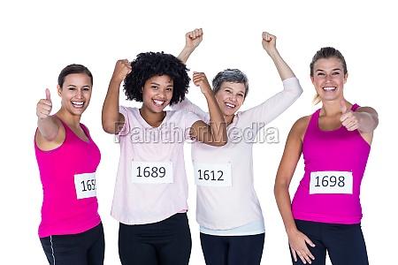 portrait of happy female athletes gesturing