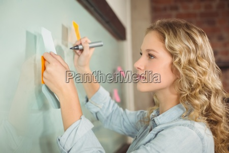 beautiful woman holding sticky note while