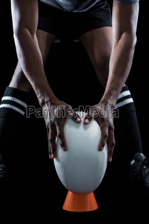mid section of rugby player keeping