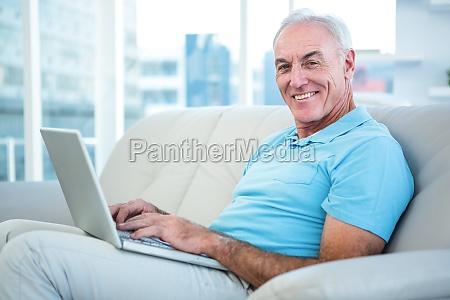 portrait of happy senior man sitting