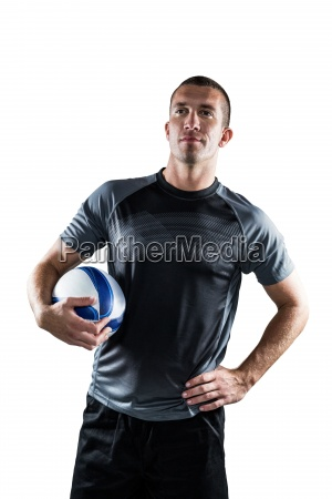 rugby player holding ball with hand