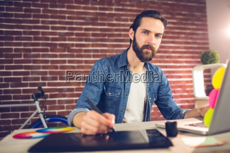 portrait of businessman writing on graphic