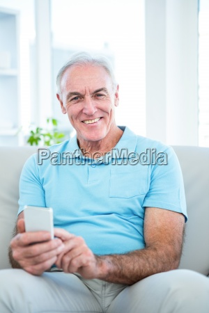 portrait of senior happy man using