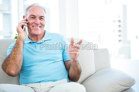 senior happy man using smartphone while
