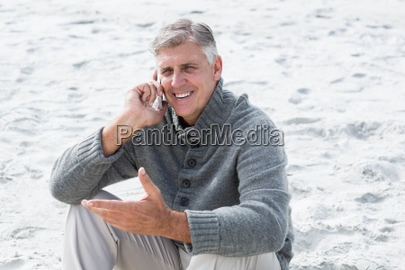 smiling man sitting and on his