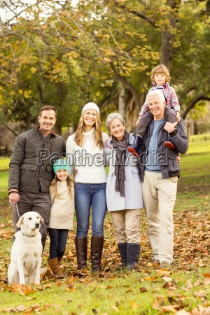 extended family posing with warm clothes