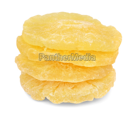 four candied pineapple whole rings stacked