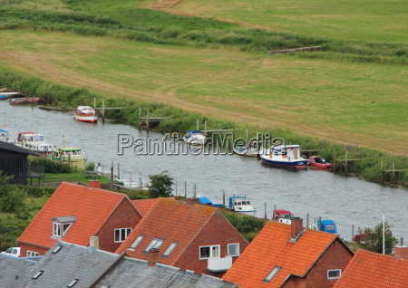 river with boats and houses in