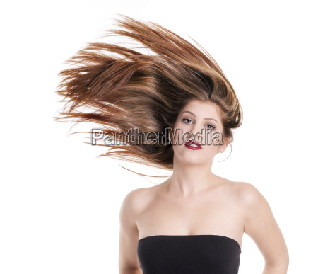 young woman shaking her hair
