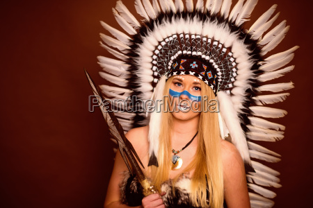 blond girl with feather headdress and