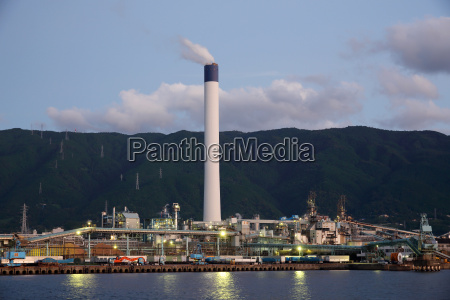 industrial refinery plant with smoke stack