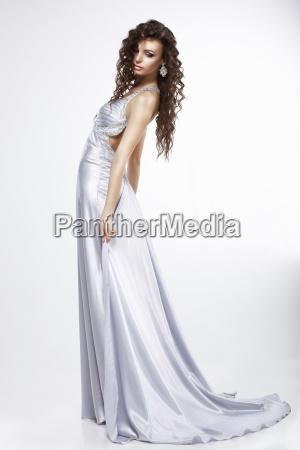 a woman in purple silk dress