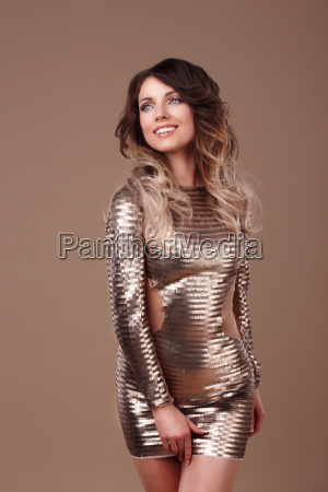 smiling woman in luxurious glitter dress