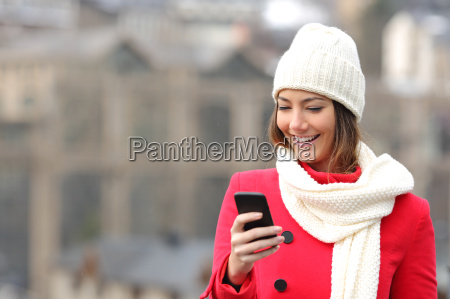 girl texting in a mobile phone