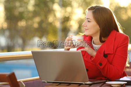 entrepreneur relaxing in a coffee shop