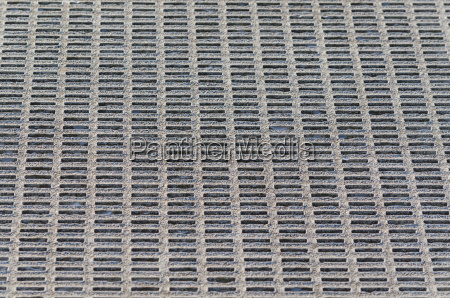 gray perforated metal grid background
