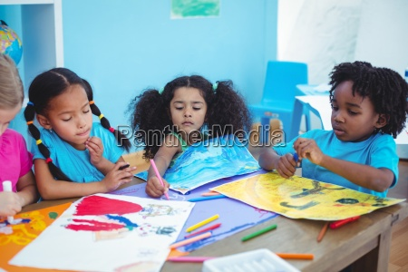 happy kids all drawing pictures