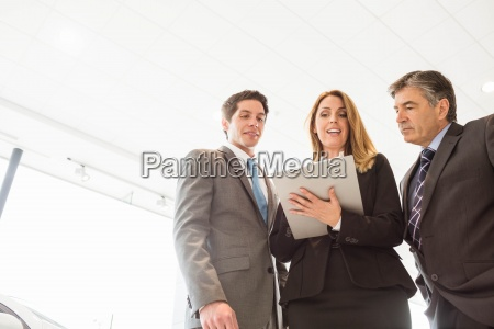 group of smiling business team standing
