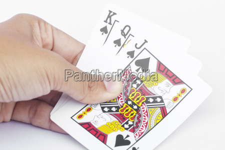 playing cards in hand isolated on