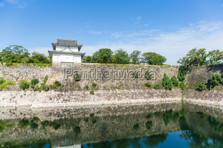 osaka castle wall at riverside in