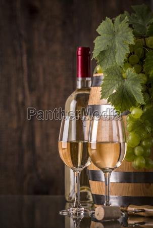 glasses of wine with bottle barrel