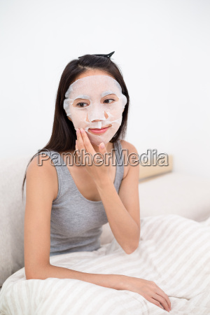 asian woman use of the paper