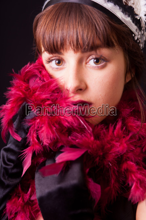 a young woman with feather boa