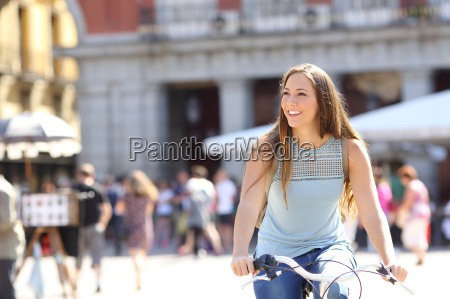 candid tourist cyclist sightseeing