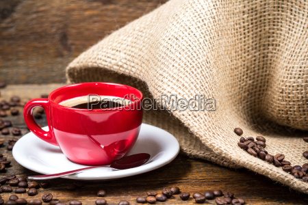 coffee cup with coffeebeans and gunny