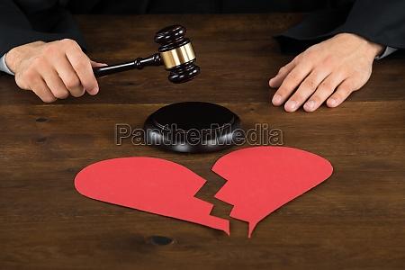 divorce lawyer with broken heart hitting