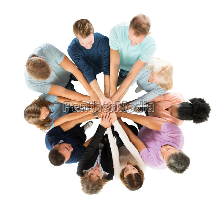 creative business people stacking hands in
